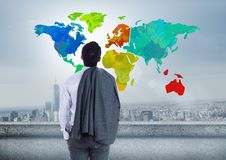 Businessman looking at Colorful Map with city background. Digital composite of Businessman looking at Colorful Map with city background Stock Photos