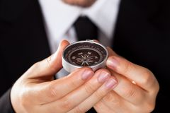 Businessman looking at a compass Royalty Free Stock Photo