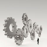 Businessman looking at  3d cog  gear to success Royalty Free Stock Photo