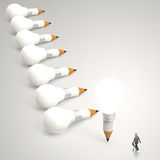 Businessman looking at 3d pencil and light bulb Royalty Free Stock Images
