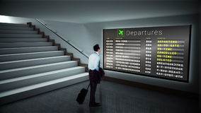 Businessman looking at departures board stock video footage