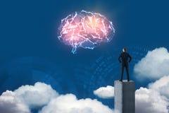 Businessman looking at digital brain Royalty Free Stock Photo