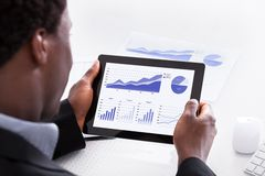 Businessman looking at digital tablet Stock Photography