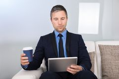 Businessman looking at digital tablet Stock Photos