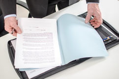 Businessman looking at a document Royalty Free Stock Photo