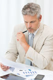 Businessman Looking At Document Stock Photography