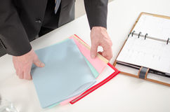 Businessman looking for documents Stock Photos
