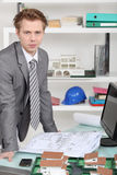 Businessman looking at drawing Royalty Free Stock Photography