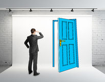 Businessman looking at drawing door Royalty Free Stock Images
