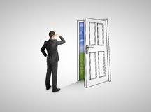 Businessman looking at drawing door Royalty Free Stock Photo