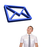 Businessman looking at email symbol Royalty Free Stock Image