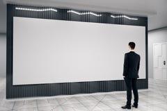 Businessman looking at empty billboard Stock Image