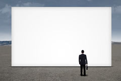 Businessman looking empty billboard Stock Images