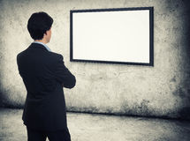 Businessman looking on the empty screen Royalty Free Stock Photography