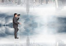 Businessman looking far away with binoculars close to a city Royalty Free Stock Photography