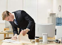 Businessman looking through file folders Royalty Free Stock Images
