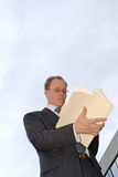 Businessman looking into files Royalty Free Stock Images