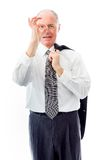 Businessman looking through finger's hole. Businessman shot in studio isolated on a white background Royalty Free Stock Photo