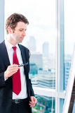 Businessman looking at flipchart Royalty Free Stock Image