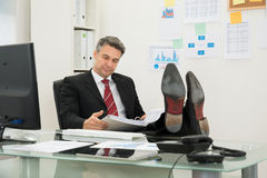 Businessman Looking At Folder Stock Photos