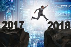 The businessman looking forward to 2018 from 2017 Stock Photo