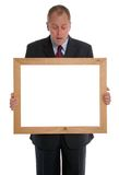 Businessman looking into frame Stock Images