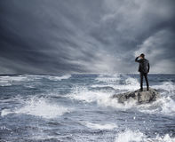 Businessman looking for the future during storm in the sea. Concept of economic crisis and problem Royalty Free Stock Photos