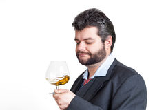Businessman looking at a glass of whisky Stock Photography
