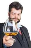 Businessman looking at a glass of whisky Royalty Free Stock Images