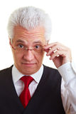 Businessman looking with glasses Royalty Free Stock Photos