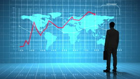 Businessman looking at global business interface with diagrams stock footage