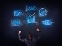 Businessman looking at glowing charts Royalty Free Stock Photo