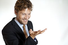 Businessman looking at hand Royalty Free Stock Images