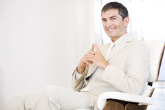 A businessman looking happy and relaxing in a chair Royalty Free Stock Photography