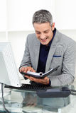 Businessman looking at his agenda Royalty Free Stock Image