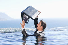 Businessman looking in his briefcase Stock Images