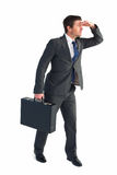 Businessman looking with his briefcase Stock Photography
