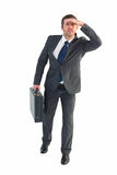 Businessman looking with his briefcase Royalty Free Stock Images