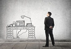 Businessman looking at his desk Stock Images