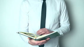 Businessman looking through his diary stock footage