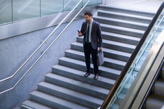 Businessman is looking at his mobile phone Royalty Free Stock Photo