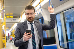 Businessman is looking at his mobile phone Stock Photos