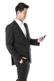 Businessman looking at his phone Stock Image
