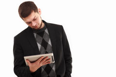 Businessman looking  at his tablet Stock Photo