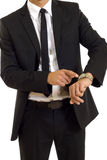 Businessman looking at his watch. Businessman looking and pointing at his watch Royalty Free Stock Image