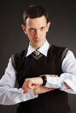 Businessman looking on his watch Royalty Free Stock Image