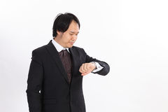Businessman looking at his watch Royalty Free Stock Images
