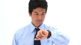 Businessman looking at his watch Stock Photography