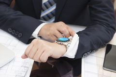 A businessman looking at his watch. Royalty Free Stock Photo