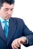 Businessman looking at his watch (clipping path included) Royalty Free Stock Images